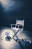 Paper director chair on a blueish grey background Royalty Free Stock Photography