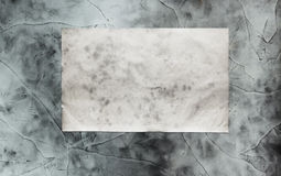 Paper on dirty wall Royalty Free Stock Images