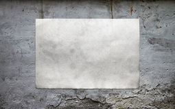 Paper on dirty wall Stock Image
