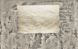 Paper on dirty wall Royalty Free Stock Photos