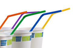 Paper disposable cups with colored tubes. Royalty Free Stock Images