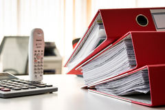Paper document file. With calculator and telephone royalty free stock images