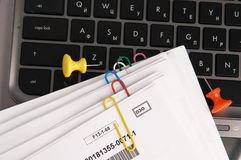 Paper documents with clips on laptop keyboard Royalty Free Stock Photo