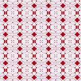 Paper doily lacy background, over red. Pretty punched-through pattern. Ideal festive or Christmas Royalty Free Stock Photos
