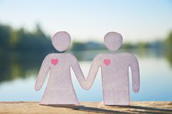 Paper doll couple holding hands Royalty Free Stock Photo