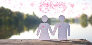 Paper doll couple holding hands Stock Photo