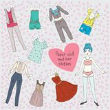 Paper doll and her clothes Royalty Free Stock Photography