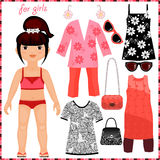 Paper doll with a set of fashion clothes. Royalty Free Stock Image