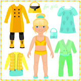 Paper doll with a set of fashion clothes. Royalty Free Stock Photos