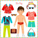 Paper doll with a set of fashionable clothing. Royalty Free Stock Photography