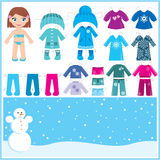 Paper doll with a set of winter clothes. Royalty Free Stock Photo