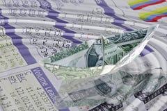 Paper dollar boat Stock Image