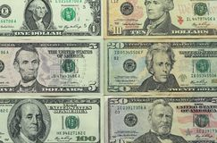 Money photo. Paper dollars of different denominations. Paper dollars of different denominations dollars. Background of dollars Stock Images