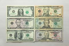 Money photo. Paper dollars of different denominations - 1, 5, 10. Paper dollars of different denominations dollars. Background of dollars Stock Photo