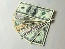 Money photo. Paper dollars of different denominations - 1, 2, 5,. Paper dollars of different denominations dollars. Background of dollars Stock Image