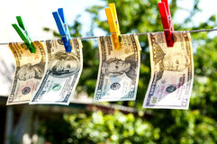 Paper dollars are drying on rope. Money are drying outdoors. Conceptual photo Stock Photos