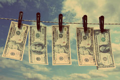Paper dollars are drying on rope - vintage retro style Royalty Free Stock Images