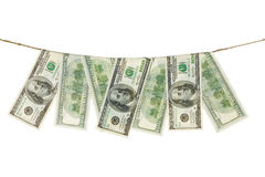 Paper dollars are drying on rope Royalty Free Stock Photo