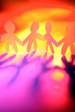 Paper dolls holding hands Royalty Free Stock Photo