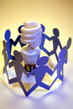 Paper Dolls with Light Bulb Royalty Free Stock Images