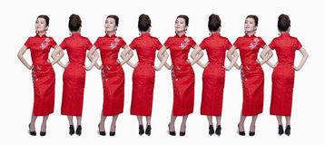Paper dolls, women in a row, red, studio show Royalty Free Stock Images