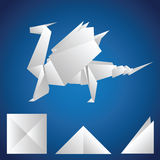 A paper dragon. On a blue background. Origami Stock Illustration