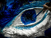 Paper Dragon's eye painting. CMU Sports day artwork of Fac. Medicine in creating dragon from paper Royalty Free Stock Image
