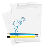 A paper with a drawing of a boy fetching a ball Royalty Free Stock Photo