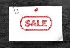 Paper with drawing sale Royalty Free Stock Photography