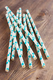Paper drink straws on wooden background Royalty Free Stock Photos