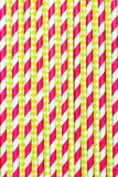 Paper drinking straws plastic pink color. Vertical background stock photos