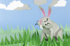Paper Easter Bunny. Rabbit made of paper in a happy paper environment Stock Images