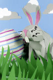 Paper Easter Bunny. Rabbit made of paper in a happy paper environment Royalty Free Stock Photography