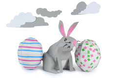 Paper Easter Bunny. Rabbit made of paper in a happy paper environment Royalty Free Stock Images