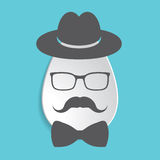 Paper Easter egg sign icon with black hat, mustache, bow tie and Stock Photography