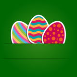 Paper easter eggs on green background Stock Image