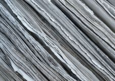 Paper Edges Macro. Macro closeup of newspaper edges showing coarse fibrous structure royalty free stock images