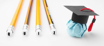 Paper education figure with graduation cap. QUIZ concept.  royalty free stock photos