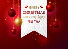 Paper emblem with type design and Christmas balls Stock Image