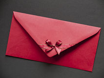 Paper envelope with bow Stock Images