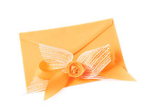 Paper envelope decorated with the bow Royalty Free Stock Photography