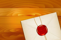Paper envelope with TOP SECRET wax seal on wooden background Stock Images