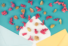 Paper envelops and colorful dried flowers, plants on blue background. Top view, flat lay. Three envelops and colorful dried flowers, plants on blue background Stock Images