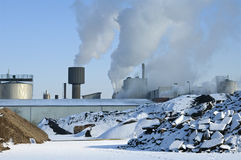 Paper factory in full swing on a cold winter day Royalty Free Stock Photos