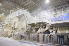 The paper factory. Industrial machinery for converting cellulose into a sheet of paper royalty free stock image