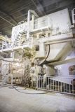The paper factory. Industrial machinery for converting cellulose into a sheet of paper stock photos