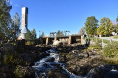 Paper factory`s tower and rapids