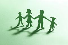 Paper family. Green paper family hand in hand Royalty Free Stock Photography