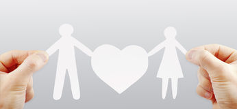 Paper family. With heart in hands Stock Image