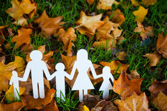 Paper family in autumn grass Stock Image